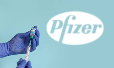 selective focus image of medical worker with blue gloves holding syringe and extracting coronavirus t20 KJ1nGE